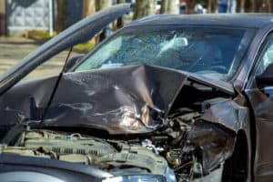 damaged car from head on collision