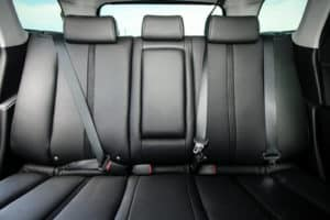 back seat of a car with seatbelt