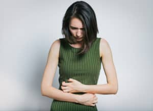 girl is facing the pain in her stomach